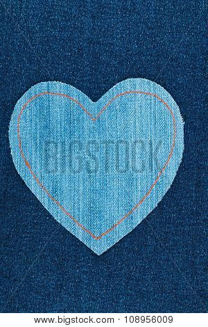 Symbolic Heart Made Of Jeans Lying On Dark Jeans