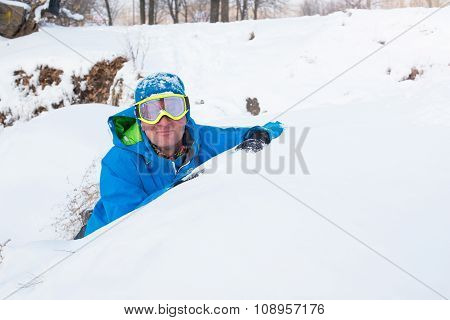 Happy Snowboarder Resting At A Ski Resort