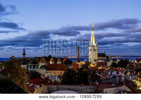 View Of The St. Olaf Cathedral  In Old Tallinn At Sunset . Estonia