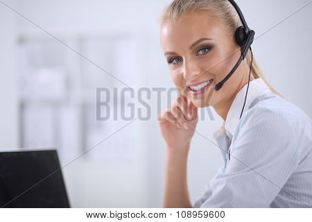 Portrait of beautiful businesswoman working at her desk with he