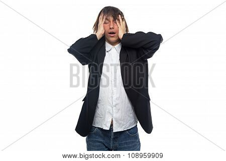 Sleepy brunette man touching his head
