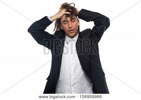 Sleepy brunette young man touching his head
