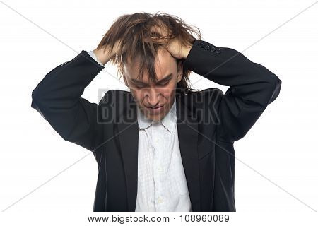 Angry young man touching his head