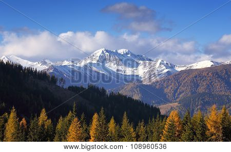 Autumn evening view of snow-capped mountains