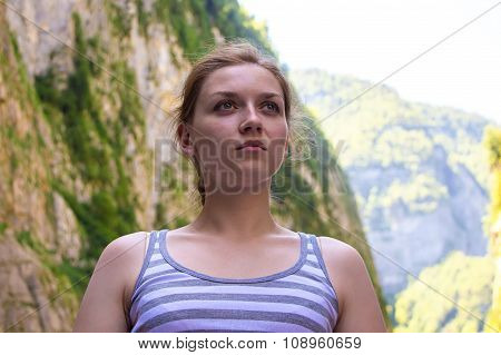 Young blond woman looking away