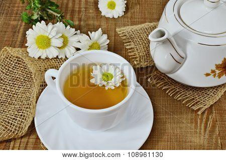 Chrysanthemum Herbal Tea In White Cup And Teapot