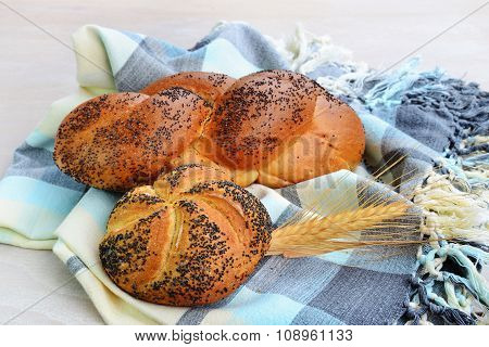 Kaiser Roll And Mohnflesserl Braided Bun Sprinkled With Poppy Seed