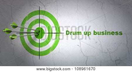 Finance concept: target and Drum up business on wall background