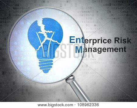 Finance concept: Light Bulb and Enterprice Risk Management with optical glass