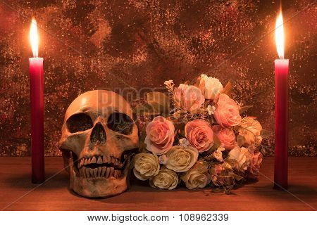 Still Life Painting Photography With Human Skull, Rose And Candle On Wooden Table