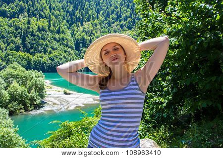 Happy young tourist with panama hat