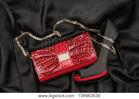 Red Bag And Shoes  Lying On Black  Fabric