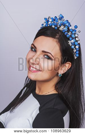 Fashion Woman With Jewelry On Light Background With Pearls Headband