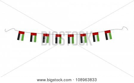 Hanging small national flags of UAE on white background. Vector design.