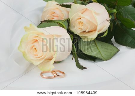 Wedding Rings And Flowers On Silk