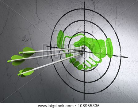 Finance concept: arrows in Handshake target on wall background