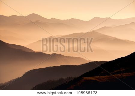 Landscape View Of Misty Mountain Hills At Sunset