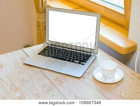 modern laptop on wood desk