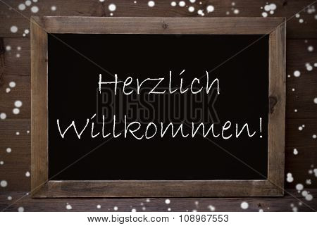 Chalkboard With Herzlich Willkommen Means Welcome, Snowflakes