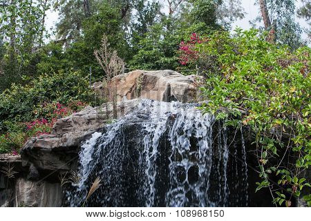 Beautiful cascade waterfall in park