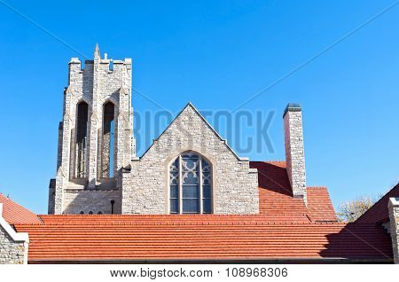 Church Bell Tower And Red Tile Roof