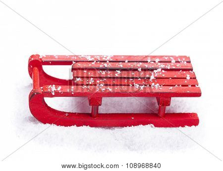Red sled with snow isolated on white background
