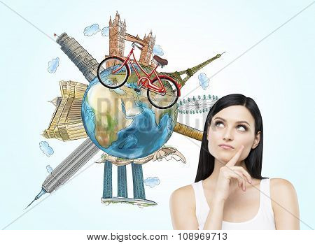 A Brunette Woman Is Dreaming About Travelling. The Globe With The Most Famous Places In The World. A