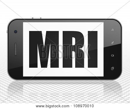 Healthcare concept: Smartphone with MRI on display