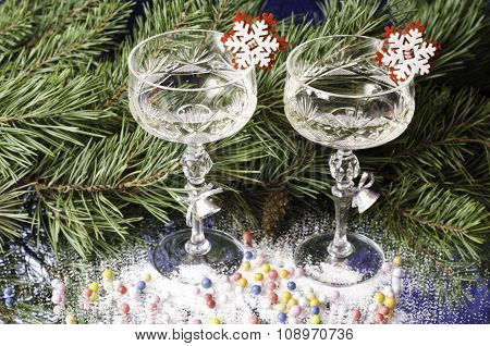 Christmas Glasses On The Background Of Spruce Branches.