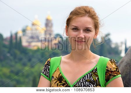 Young woman portrait on background of New Athons