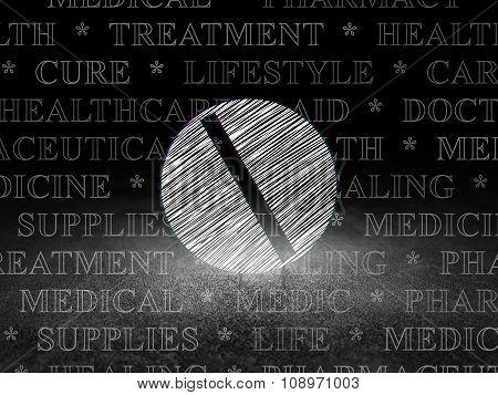 Health concept: Pill in grunge dark room