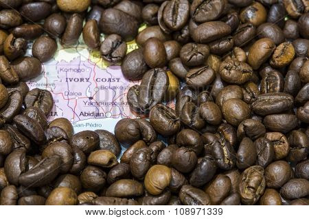 Map Of Ivory Coast Under A Background Of Coffee Beans