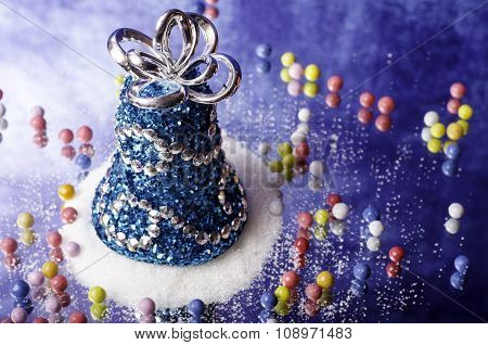 Christmas Bell Snowdrift And Small Candies.