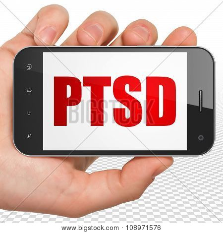 Healthcare concept: Hand Holding Smartphone with PTSD on display