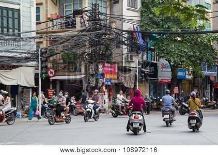 Hanoi, Vietnam - Circa August 2015: People Riding Motorbikes In Street Traffic In Hanoi,  Vietnam