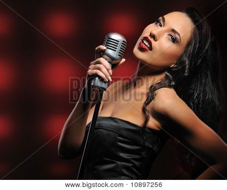 Beautiful singer over an abstract background
