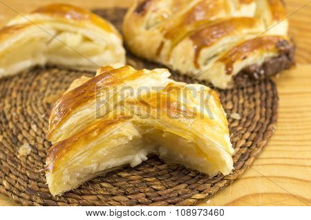 Sweet Pie Slices On A Wooden Table