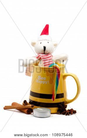 Yellow Mug With Cinnamon, Candle And Bear