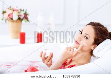 Charming girl taking a bath
