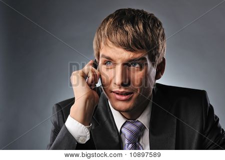 Businessman talking on mobile bphone