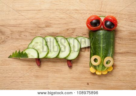 Crocodile Made Of Vegetables On Wooden Background