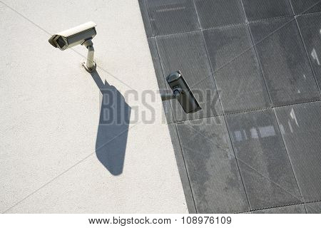 White Security Cameras On Wall
