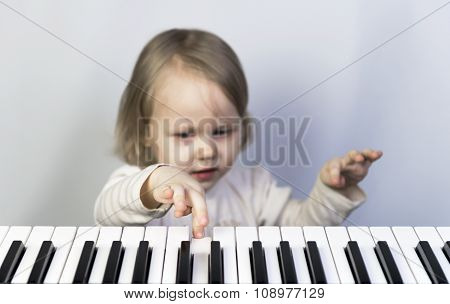 Little Girl Learning To Play The Piano