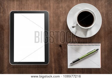 Notepad With Pencil, A Tablet And Coffee On A Living-room Table