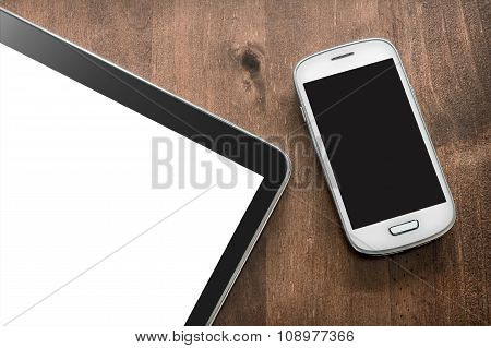 Smartphone And Tablet On A Living-room Table