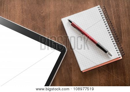 Notepad With Pencil And Tablet On A Living-room Table