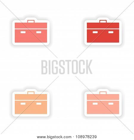 assembly realistic sticker design on paper briefcase