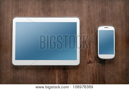 Tablet And Smartphone On Vintage Table