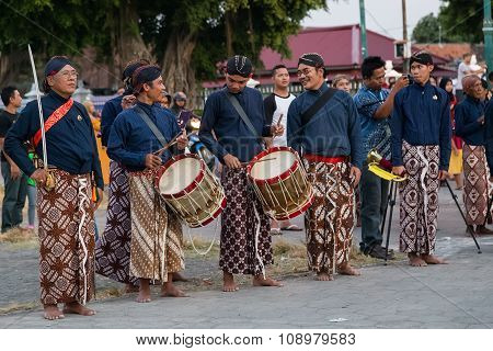 Yogyakarta, Indonesia - Circa September 2015: Ceremonial Sultan Guards In Sarongs Standing In Front