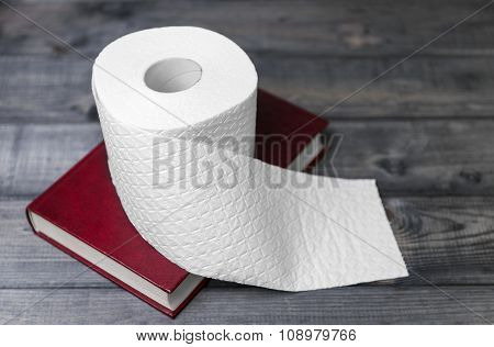 Hardcover Red Cover To Read And White Embossed Roll Of Toilet Pa